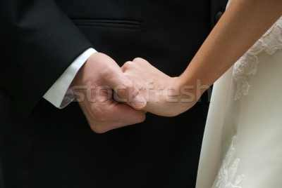 1241998_stock-photo-loving-couple-holding-hands