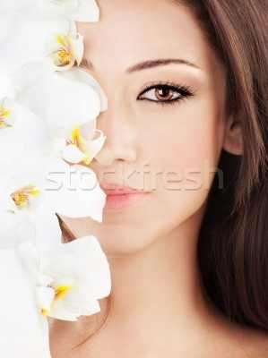 1257490_stock-photo-closeup-on-beautiful-face-with-flowers
