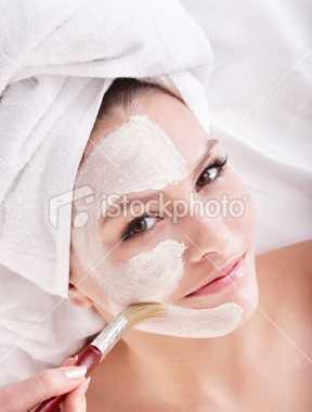 stock-photo-14159226-young-woman-with-clay-facial-mask