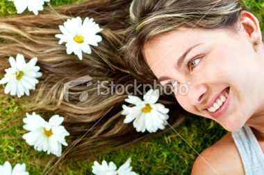 stock-photo-19630489-woman-in-a-garden-of-daisies