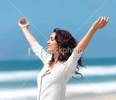 stock-photo-6244050-pretty-young-woman-with-arms-raised
