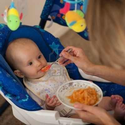 4174123-mother-is-feeding-little-caucasian-girl-with-solid-food
