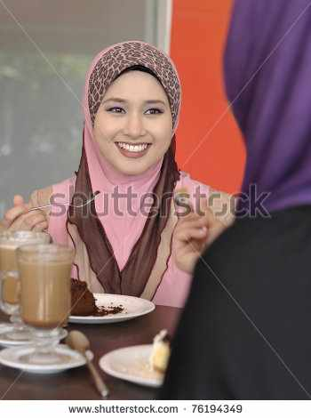stock-photo-pretty-muslim-girl-chatting-with-her-friend-at-cafe-76194349
