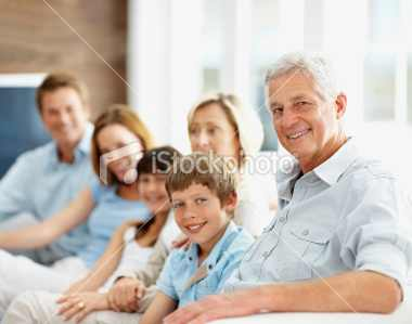 stock-photo-11815650-happy-family-sitting-together-while-at-home