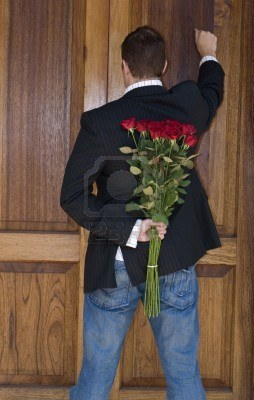 2482704-man-knocking-on-door-to-present-flowers-to-his-date-on-valentines-day