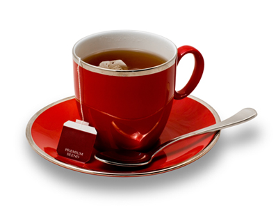 Full Red Teacup and Saucer with Teabag Isolated on White