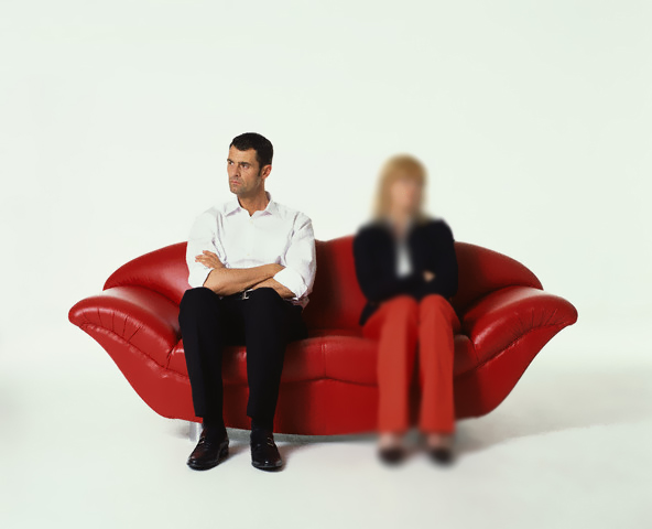 Speechless Couple Sitting on Red Sofa
