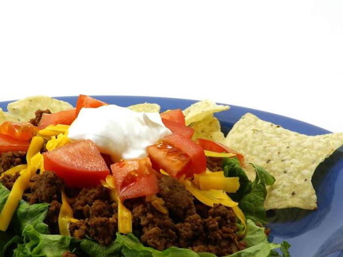 Taco salad with beef and tomato sauce