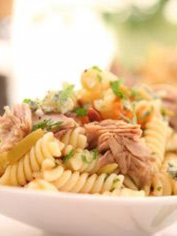 Pasta salad with tuna and black olives and green