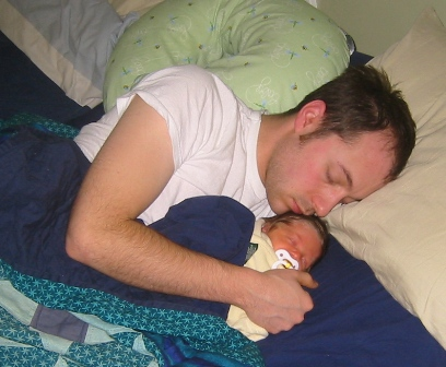 new-father-sleeping-with-newborn-baby