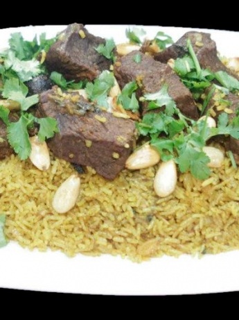 Biryani with meat and onions