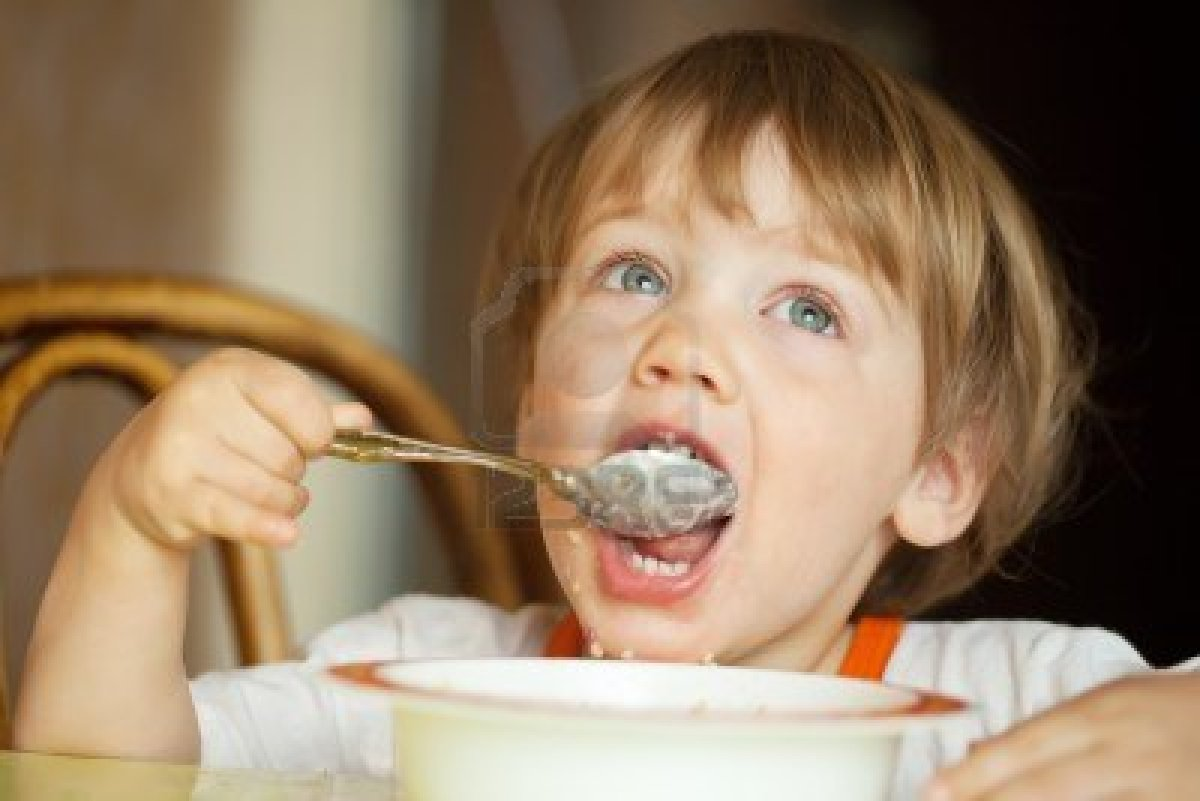 13849659-child-himself-eats-cereal-with-a-spoon
