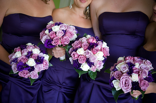 Lisa White's bridesmaids carried bouquets of various roses.