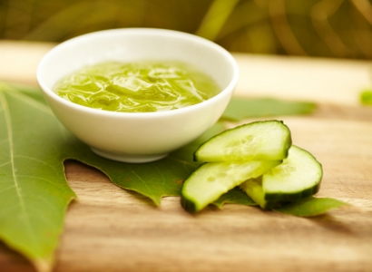 Seaweed facial product at spa with cucumber on maple leaf