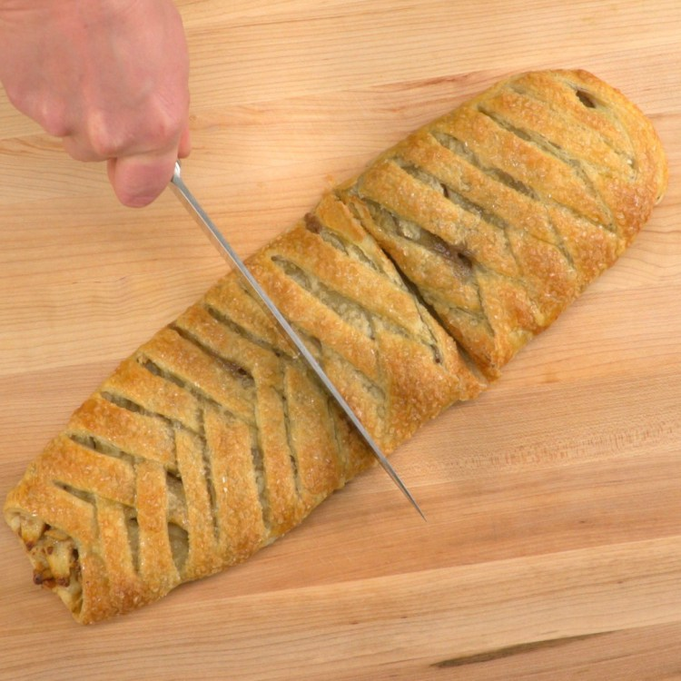 slicing-braided-apple-walnut-strudel